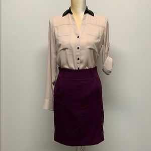 XS Express blouse with faux leather collar.